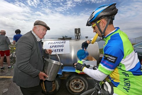 John Garvey, Foilmore, the famous Water man at Coomikista, providing Foilmore Spring Water to cyclist, Paul Fellows, taking part in the 33rd Annual Ring of Kerry Charity Cycle.  Photograph: Valerie O'Sullivan