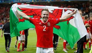 Wales' Chris Gunter celebrates after beating Belgium to reach the Euro 2016 semi-finals. Gunter will now miss his brother's wedding to play in the match. Photo: Reuters
