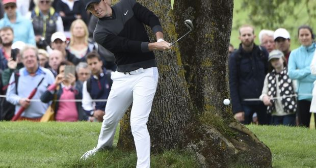 9cc24b3b08c1 Rory McIlroy hits out from under a tree on the 3rd hole during the last  round