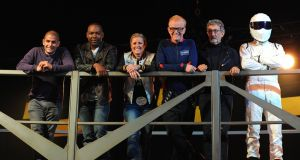 Top Gear presenters (left to right): Chris Harris, Rory Reid, Sabine Schmitz, Chris Evans, Eddie Jordan and The Stig. Evans says he is quitting the show.  File photograph: Andrew Matthews/PA Wire