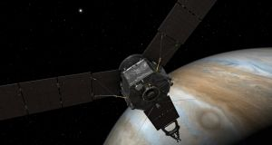 An artist's rendering of Nasa's Juno spacecraft at Jupiter, with its solar arrays and main antenna pointed toward the distant sun and Earth. Photograph: Nasa