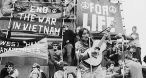 Joan Baez performs at an anti-Vietnam War demonstration in London, 1965. Photograph: Keystone/Hulton Archive/Getty Images