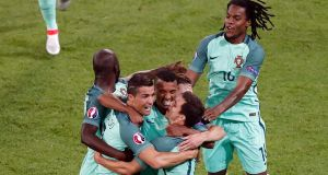 Portugal celebrate Nani's goal in their 2-0 win over Wales in Lyon. Photograph: AP