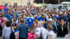 Tipperary and Waterford fans on their way to Semple Stadium for last year's Munster hurling final. Photograph: Morgan Treacy/Inpho.