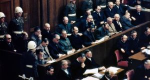 Guilty as charged: defendants (in the two central rows) at the Nuremberg war crimes trials in 1946, including Hans Frank (front, fifth from right). Photograph: Raymond D'Addario/Galerie Bilderwelt/Getty