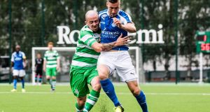 Shamrock Rovers' Gary McCabe tackles  Jarkko Lahdenmäki of RoPS during the  Uefa Europa League first qualifying round, second leg at Keskuskenttä, Rovaniemi in Finland. Photograph:   Anssi Jokiranta/Inpho