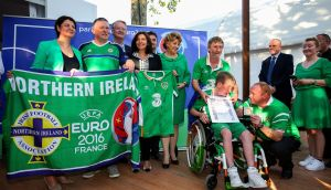 Republic of Ireland supporter Jamie Monaghan, from Togher, Co Louth, and Northern Ireland supporter Jim Spratt who were selected to accept the prestigious 'Médaille de la Ville de Paris' from the Mayor of Paris Anne Hidalgo, which has been awarded to Irish fans for their 'exemplary behaviour' at Euro 2016. Photograph:  Gwendoline le Goff/Uefa via Sportsfile.