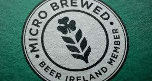 "Microbrewed in Ireland is a logo created by Beer Ireland  ""to help drinkers identify beers that are brewed by microbreweries in Ireland and aren't a macro produced imitation""."