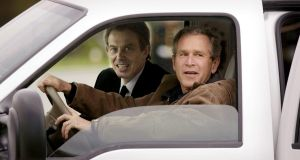 US President George W. Bush (R) drives with British Prime Minister Tony Blair (L) in his truck after Blair arrived at the Bush's Prairie Chapel Ranch 05 April 2002 in Crawford, Texas.  STEPHEN JAFFE/AFP/Getty Images