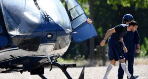 France's captain and goalkeeper Hugo Lloris ducks down as he leaves a helicopter before  a press conference at the Stade de France ahead of the European Championship final against Portugal on Sunday night. Photograph: Franck Fife/AFP/Getty Images