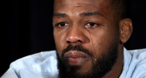 Jon Jones cries as he speaks during a news conference in Las Vegas  to address being pulled from his light heavyweight title fight at UFC 200 against Daniel Cormier due to a potential violation of the UFC's anti-doping policy. Photograph: Ethan Miller/Getty Images