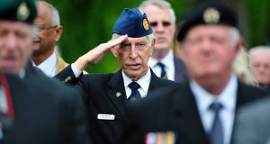 Noel Murphy  salutes during the playing of the National Anthem at  the State ceremony to commeorate the centenary of the Battle of The Somme in the National War Memorial Gardens in Islandbridge, Dublin. Photograph: Aidan Crawley.