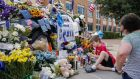 A police car  in front of the Dallas Police Department headquarters is  converted into a memorial after the ambush shooting of police officers in Dallas, Texas. Photograph: Erik S Lesser/EPA