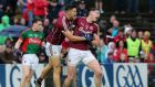 Thomas Flynn celebrates with Damien Comer after scoring Galway's winning goal against Mayo in the Connacht championship semi-final at McHale Park last month. Photograph: Lorraine O'Sullivan/Inpho.
