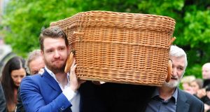 Danny Erskine, son of Anita Reeves, and Julian Erskine, her husband, carry her coffin into the Mansion House in Dublin for her funeral on Saturday. Photograph: Aidan Crawley.
