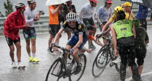 Ireland's Daniel Martin and Britain's Christopher Froome, wearing the overall leader's yellow jersey ride under the rain as fans cheer during the 184,5 km ninth stage of the 103rd edition of the Tour de France. Photograph: Getty Images