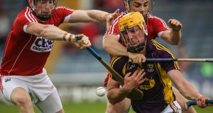 Cork's Damien Cahalane and Conor O'Sullivan tackle Wexford's Podge Doran at Semple Stadium in Thurles. Photograph: Cathal Noonan/Inpho