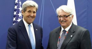 "US secretary of state John Kerry   with Poland's foreign minister Witold Waszczykowski at the Nato summit in Warsaw, Poland.  Mr Waszczykowski said Europe and the US need  ""a more active, energetic Nato that takes practical steps to ensure the real safety of its citizens."" Photograph: Jerzy Dudek/Reuters"