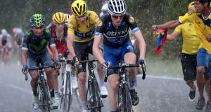 Dan Martin is followed by Chris Froome, wearing the overall leader's yellow jersey, during the 184.5km ninth stage of the Tour de France. Photograph: Getty.