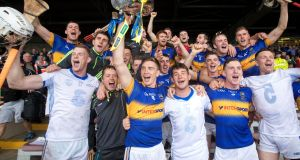 Tipperary celebrate with the trophy after beating Waterford at the Gaelic Grounds. Photograph: Ryan Byrne/Inpho