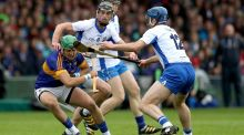 Waterford's Michael Walsh closes down Tipperary's James Barry. Photograph: Ryan Byrne/INpho