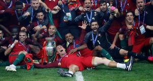 Portugal celebrate their Euro 2016 victory. Photograph: Reuters