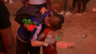 The beautiful game: Portuguese boy comforts crestfallen French fan