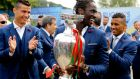 Eder holds the Euro 2016 trophy before leaving Marcoussis on Monday morning. Photograph: EPA
