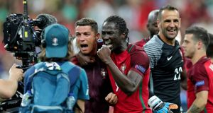 Portugal's Cristiano Ronaldo and Eder celebrate their team's victory in Stade de France. Photograph: EPA