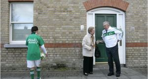 Former Irish football player John Giles outside the house he grew up in Ormond Sq in Dublin 1 in 2012 when his old neighbour Angela Ryan came up to greet him.  Photographer: Dara Mac Dónaill/The Irish Times