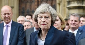 Prime minister-in-waiting Theresa May flanked by colleagues outside parliament in London. Photograph: Andy Rain/EPA