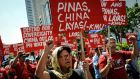 Anti-China protesters  protest against China's territorial claims in the Spratly  islands in the South China Sea in front of the Chinese Consulate on July 12th, 2016, in Makati, Philippines. Photograph: Dondi Tawatao/Getty Images