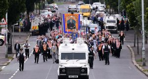 The Twelfth of July Orange Order march arrives onto the Crumlin Rd in Belfast, Northern Ireland. Photograph: Clodagh Kilcoyne/Reuters
