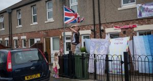 A family outside their house in Sunderland, where Brexit was heavily backed, on June 26th, days after the referendum. Photograph: Adam Ferguson/The New York Times