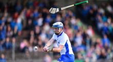 Waterford's Stephen Bennett keeps his concentration despite a stray hurl to score his second goal in the  Bord Gáis Energy Munster Under-21 Hurling  semi-final against  Clare at Walsh Park. Photograph:   Stephen McCarthy/Sportsfile