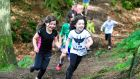 Children running with the Trail Kids group in Cruagh Woods in the Dublin mountains. Photograph: Aidan Crawley