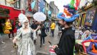 Marie Antoinette (Tara Breathnach) gives advice on headwear at Quay Street in Galway city on Thursday during a street theatre production to mark Bastille Day. Photograph: Joe O'Shaughnessy