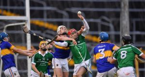 Barry Nash of Limerick in action against Ronan Maher of Tipperary during the Bord Gáis Energy Munster U21 Hurling Championship Semi-Final match between Tipperary and Limerick at Semple Stadium in Thurles, Co Tipperary. Photo: Sportsfile