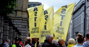 ASTI protest: The Department of Education said that penalties, which were provided for under financial emergency legislation (Fempi Act) introduced last year, would be applied to teachers in voluntary secondary schools as the ASTI was the representative union in this sector. Photograph: Cyril Byrne