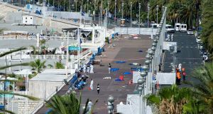 Crime scene investigators work on the 'Promenade des Anglais' after the truck crashed into the crowd during the Bastille Day celebrations in Nice. Photograph: EPA