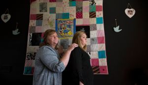Sandra Flynn  and her daughter Jasmine in front of a patchwork quilt they had made from Kayleigh Flynn's favourite clothes. Kayleigh, Sandra's daughter, was 16 years old when she  died. Photograph: Laura Hutton/The Irish Times