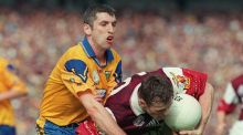 Jarlath Fallon of Galway keeps possession despite the attentions of Roscommon's Damien Donlon during the Connacht final in 1998. Photograph: Inpho.