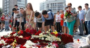 People pay tribute to the victims of the July 14th terrorist attack in Nice at a memorial place in front of the French embassy in Moscow, Russia. Photograph: Sergei Chirikov/EPA