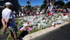 Flowers and candles placed in tribute to the victims of the deadly Bastille Day attack in Nice. Photograph: AFP