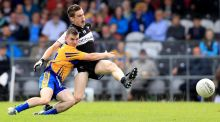 Martin McMahon tackles Kyle Cawley during Clare's qualifier win over Sligo. Photograph: Inpho/Donall Farmer