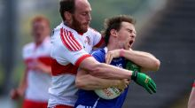 Cavan's Sean Johnston is tackled by Ciarán Mullan during Derry's qualifier win at Breffni Park. Photograph: Inpho/ Tommy Dickson