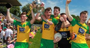 Donegal players celebrate their Ulster minor title win after beating Derry in the final in Clones. Photograph: Inpho