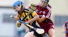 Kilkenny's Claire Phelan is tackled by Niamh McGrath of Galway in Saturday's All-Ireland senior camogie clash in St Lachtain's Park, Freshford, Kilkenny. Photograph: Ken Sutton/Inpho