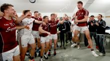 Champions!  Galway's Eoghan Kerin celebrates with his team mates after the game. Photograph: James Crombie/Inpho