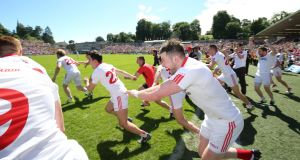 Tyrone players celebrate at the final whistle in Clones. Photograph: Lorraine O'Sullivan/Inpho